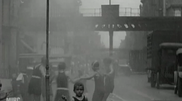 "Screenshot from the video ""Fire Engines, and Children at Play"" (The Roaring Twenties/NYC Dept. of Records, Municipal Archives)"