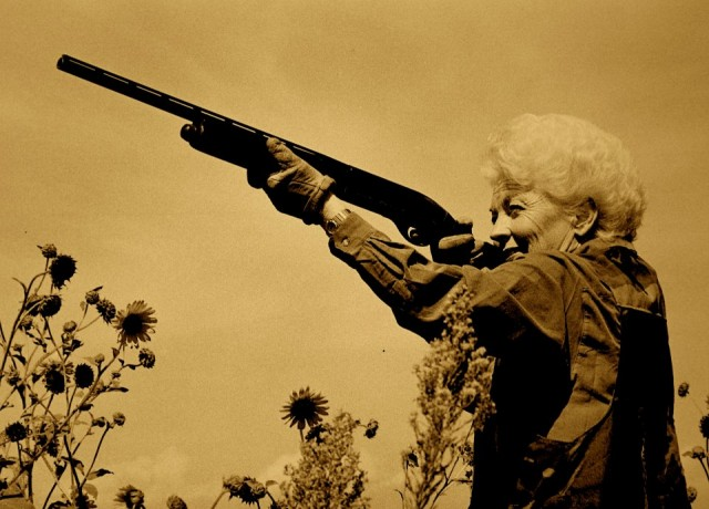 "Image of Ann Richards firing a gun from the film, ""Backwards and In High Heels"" (Texas Democrats)"