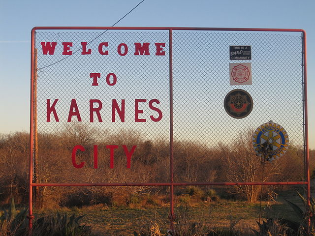 Welcome Sign to Karnes City, Texas. Via Wikimedia Commons.