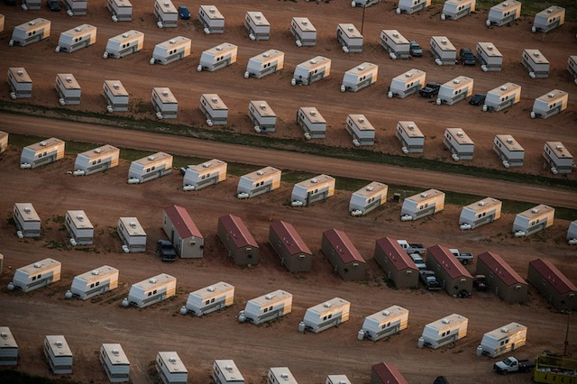 A trailer park occupied mostly by oil workers is seen in an aerial view in the early morning hours of July 30, 2013 near Watford City, North Dakota. Photo by Andrew Burton/Getty Images