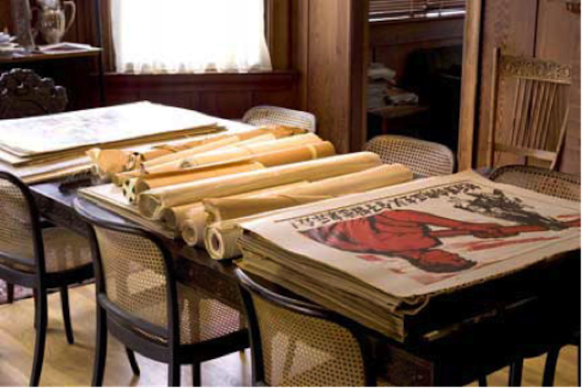 Posters from the Ann Tompkins collection on the Cushing dining room table, some tightly rolled for more than thirty years.