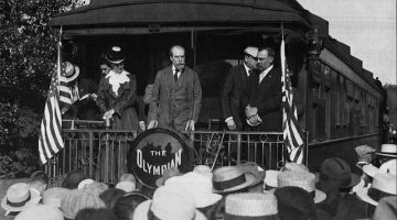 """""""Charles Evans Hughes campaigns in Winona, Minnesota on the Milwaukee Road's Olympian"""". Via Wikipedia Commons."""