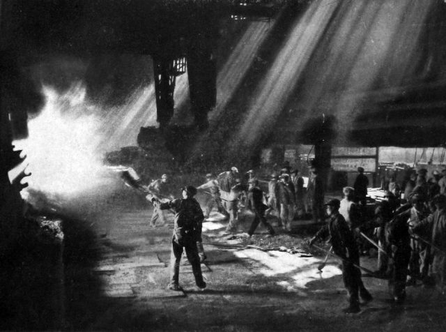 Chinese workers in front of the open hearth furnace, September 1958. Via Wikimedia Commons