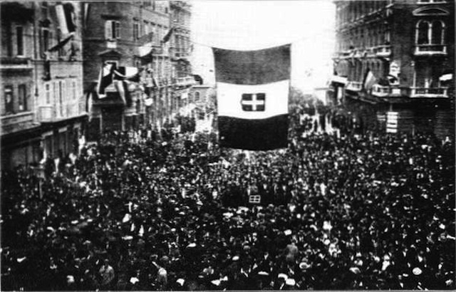 Residents of Fiume cheer the arrival of Gabriele d'Annunzio and his blackshirt-wearing nationalist raiders. D'Annunzio and Fascist Alceste De Ambris developed the quasi-fascist Italian Regency of Carnaro, a city-state in Fiume, from 1919 to 1920. D'Annunzio's actions in Fiume inspired the Italian Fascist movement. Via Wikipedia.