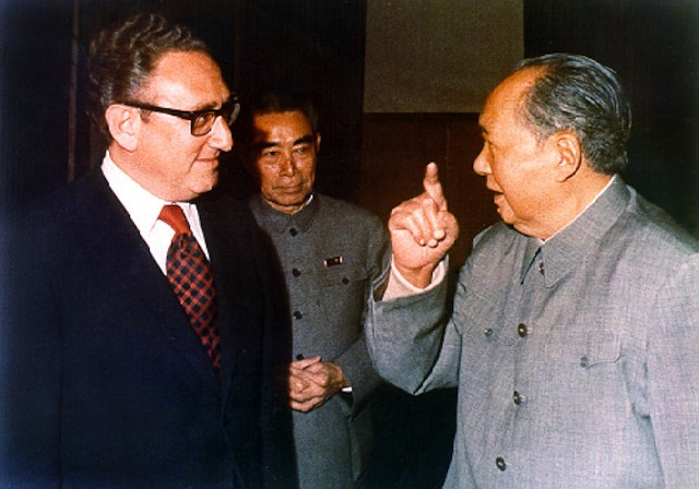 Henry Kissinger and Chairman Mao, with Zhou Enlai behind them in Beijing, early 70s. Via Wikipedia.