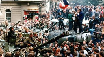 People standing on cars and military vehicles in crowded streets during the so-called Prague Spring reform