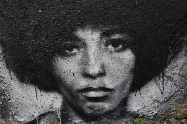 Portrait of Angela Davis spray-painted on a wall.