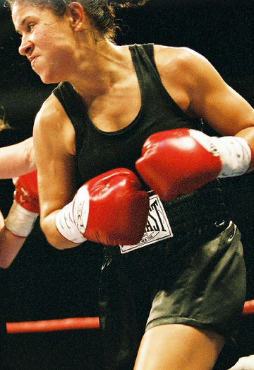 "Image of Anissa ""The Assassin"" Zamarron in the midst of a boxing fight"