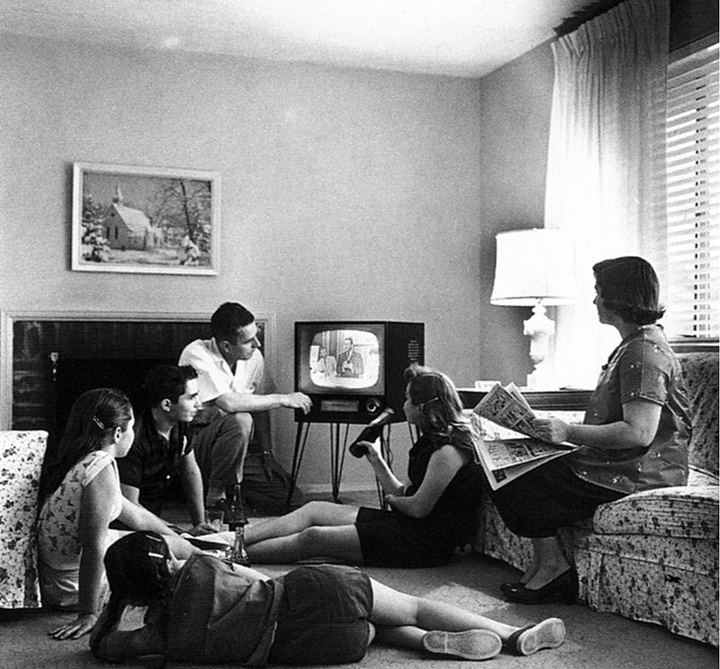 Black and white photograph by Evert F. Baumgardner from 1958 entitled by Family Watching Television