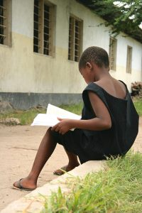 Child_studying_in_Dar_es_Salaam_1