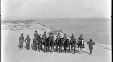 Black and white image of members of the Texas Border Patrol with some on horseback