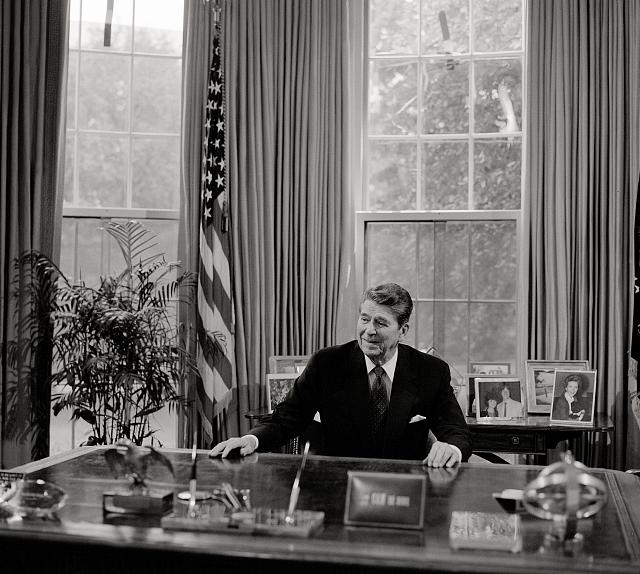 President Ronald Reagan at his desk in the Oval Office (Library of Congress)