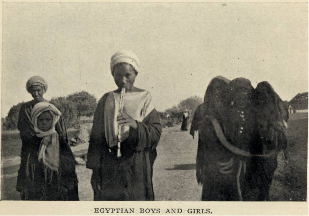 Photograph of Egyptian boys and girls walking down a road, 1911 (Sladen, Douglas Egyptian Boys And Girls. (1911). From Travelers in the Middle East Archive (TIMEA). http://hdl.handle.net/1911/21592)
