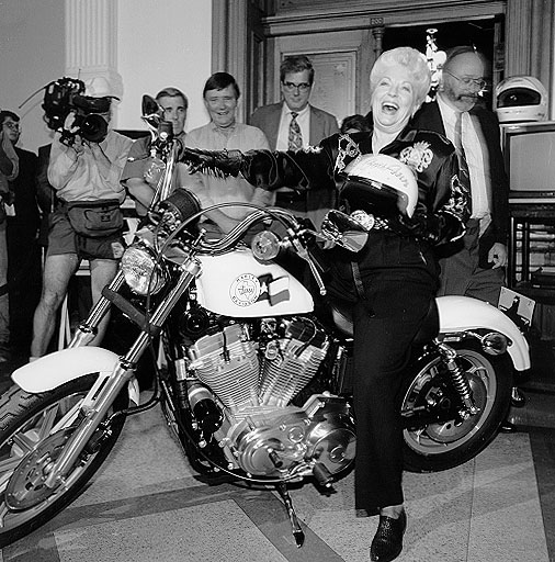 Ann Richards poses on a motorcycle (Texas State Library and Archives Commission)