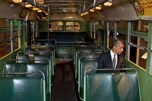 President Barack Obama sitting in the Montgomery bus where Rosa Parks was arrested. Parks was sitting in the same aisle but on the opposite side. (The White House)