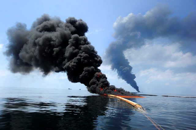 A controlled fire in the Gulf of Mexico following the Deepwater Horizon oil spill, May 6, 2010. The U.S. Coast Guard conducted the burn to help prevent the spread of oil. (U.S. Military)