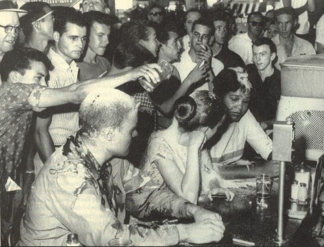 Fred Blackwell's photograph of the sit-in at the Woolworth's in Jackson, Mississippi. The woman with the back of her head facing the camera is Joan Mulholland