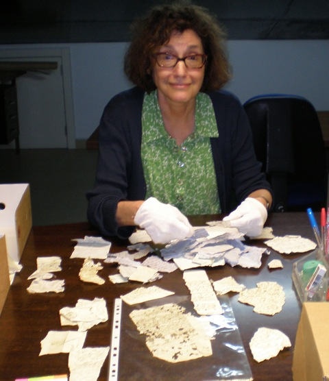 Professor Bodian examining documents in the Azores geniza