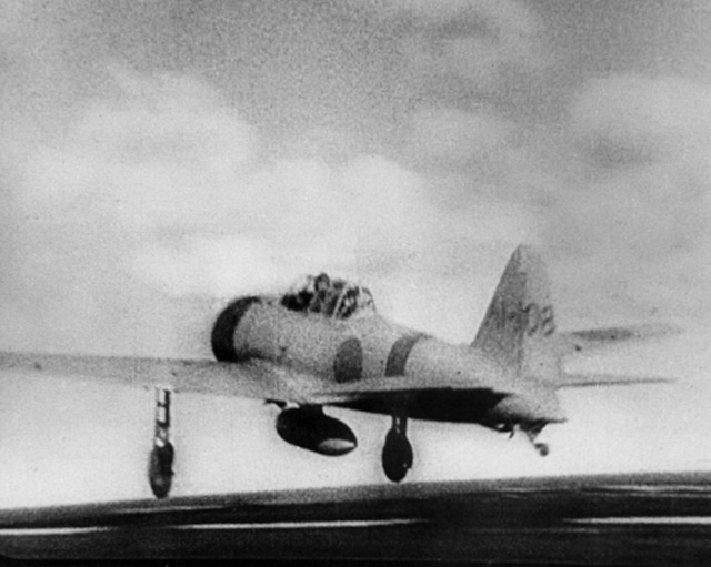 "A Japanese Navy Mitsubishi A6M2 ""Zero"" fighter (tail code A1-108) takes off from the aircraft carrier Akagi, on its way to attack Pearl Harbor during the morning of 7 December 1941."