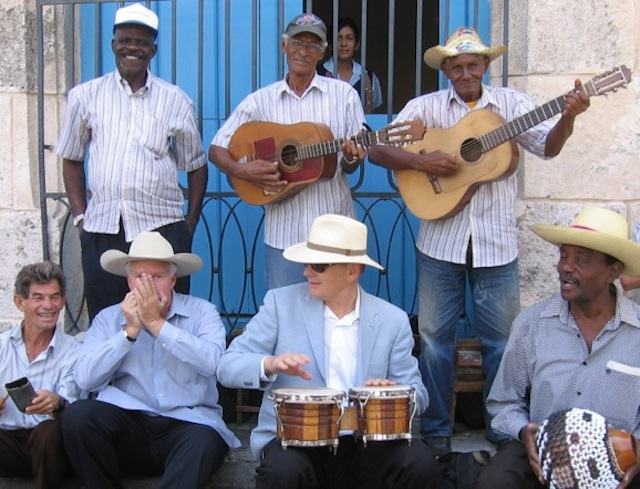 Two visiting yankis sit in with a Havana street band. The author plays the bongos and on my right, John Parke Wright, a Florida cattleman, riffs on the harmonica.