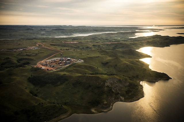 An oil drilling rig is seen in an aerial view in the early morning hours of July 30, 2013, North Dakota. (Photo by Andrew Burton/Getty Images)