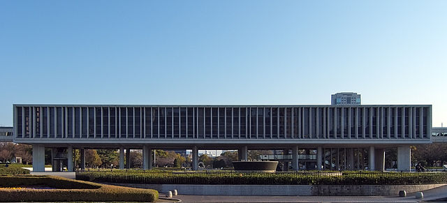 Hiroshima Peace Memorial Museum, at Naka-ku Hiroshima Japan, design by Kenzo Tange in 1955. Via Wikimedia Commons.