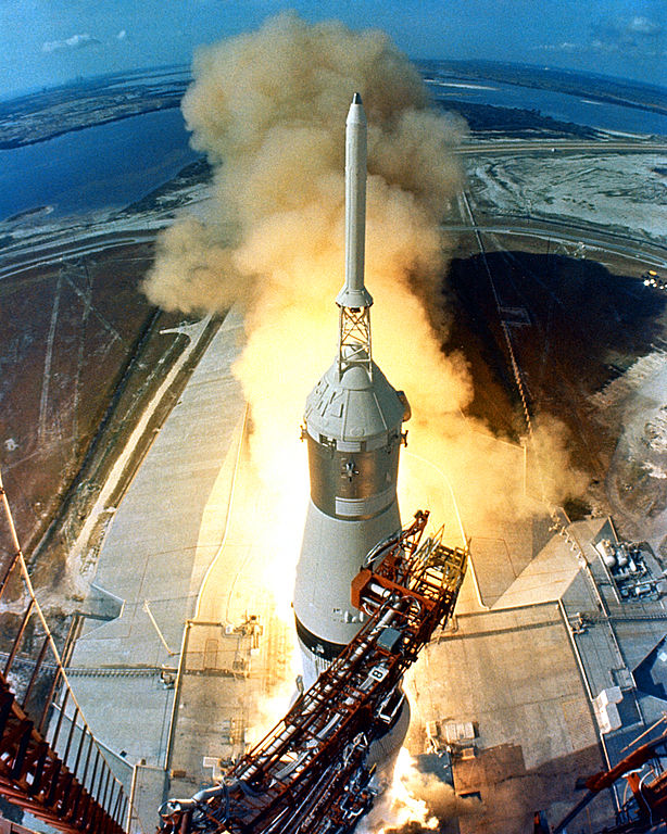 Saturn V carrying Apollo 11 rises past the launch tower camera