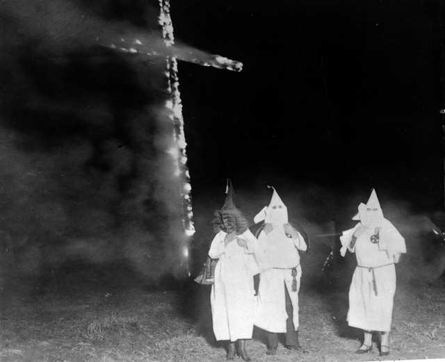 Ku Klux Klan members and a burning cross, Denver, Colorado, 1921.The KKK was founded by former Confederate soldiers after the Civil War. Courtesy of the Library of Congress.