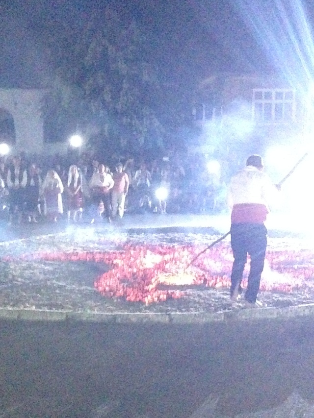 1The Nestinarka or coal-walker (in white head scarf) swirls a small urn of burning embers in the air at the beginning of the procession with holy icons into the woods. (Village of Bulgari, in Southeastern Bulgaria, June 2015).