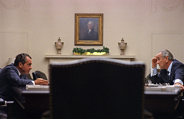 Lyndon Johnson and Richard Nixon at the White House in 1968. Via Wikimedia Commons.