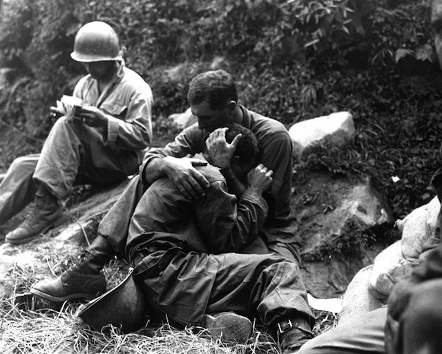 Reality of Korean War: A G.I. comforts a grieving infantryman. Via Wikipedia