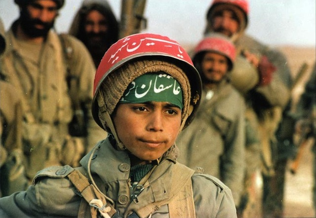 Iranian child solider on the front-line of the war. Via Wikipedia.