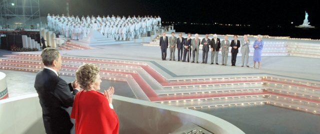7/3/1986 President and Nancy Reagan at the Opening Ceremonies of Liberty Weekend with medals of liberty recipients Henry Kissinger, Franklin Chang-Diaz, I.M. Pei, Itzhak Perlman, James Reston, Kenneth Clark, Albert Sabin, An Wang, Elie Wiesel, Bob Hope, Hanna Holburn, Lee Iacoccaat Governors Island, New York