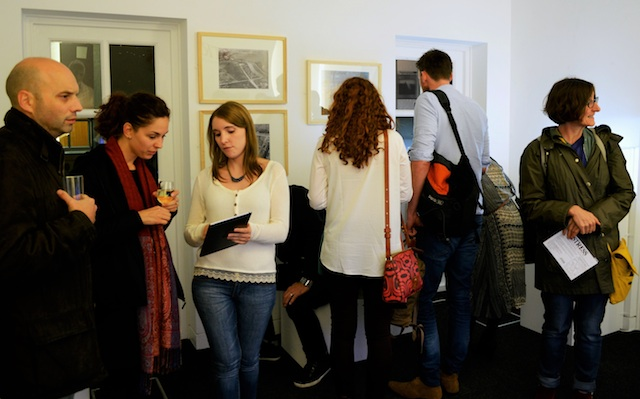 Members of the Student Engagement Team discuss the exhibition with visitors.