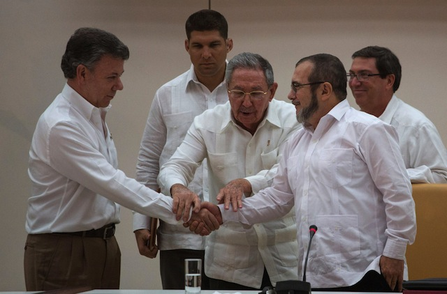 President Raúl Castro of Cuba, center, with President Juan Manuel Santos of Colombia, left, and Rodrigo Londoño, of FARC. Courtesy of Desmond Boylan/Associated Press
