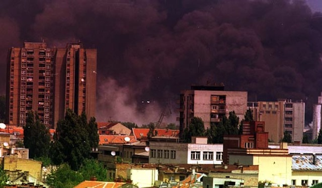 Smoke in Novi Sad, Serbia after NATO bombardment in 1999, via Wikipedia.