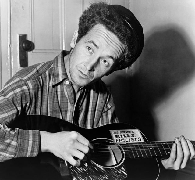"Woody Guthrie's famous guitar slogan, ""This machine kills fascists."". Via Wikipedia"