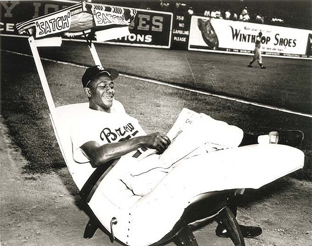 "St. Louis Browns pitcher Leroy ""Satchel"" Paige relaxing in his bullpen rocking chair during a game, 1947. Courtesy of the Missouri History Museum."
