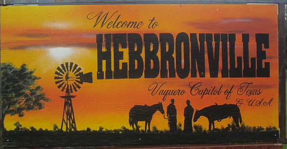 Welcome sign for Hebbronville, 'The Vaquero Capitol of Texas and the USA.' Photo from 2011. Via Wikipedia.