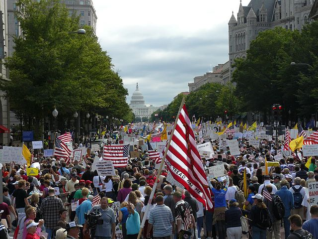 Tea Party protesters walk towards the United States Capitol during the Taxpayer March on Washington, September 12, 2009. Via Wikipedia.