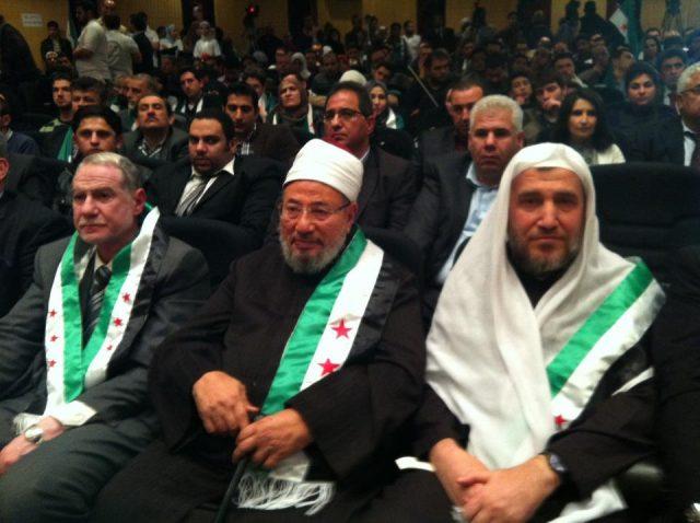 qaradawi_wih_free_syria_flag