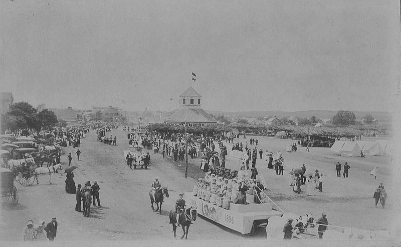 Fredericksburg, TX in 1896. The photograph shows the 50th Anniversary parade celebrating the 1846 founding of the town, with the Vereinskirche in the background (via Wikimedia)
