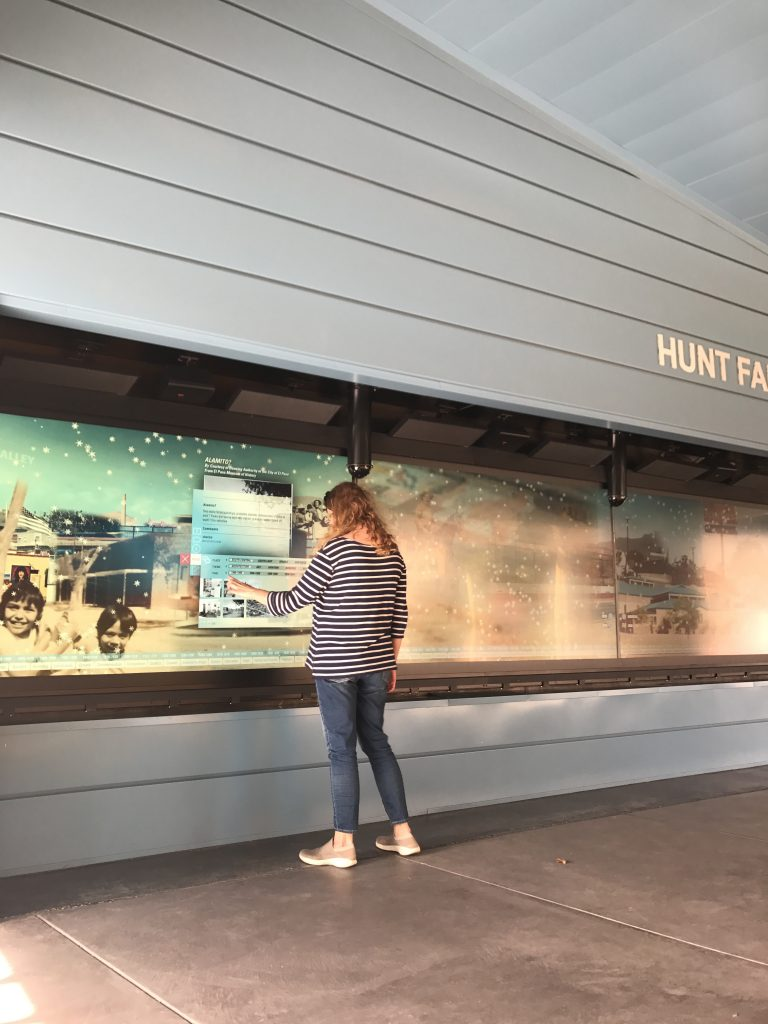 Photograph of a woman using the El Paso Museum of History's interactive display