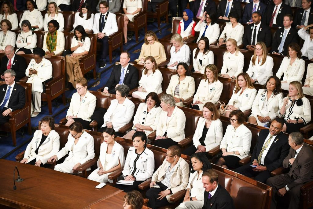 Photograph of women Congress members wearing white attend President Trump's State of the Union address at the US Capitol on February 5, 2019
