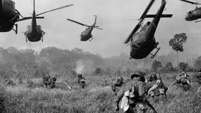 US Army helicopters pour machine-gun fire into the tree line to cover the advance of ground troops