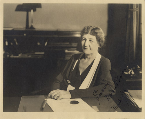 Ma Ferguson sitting at her desk.