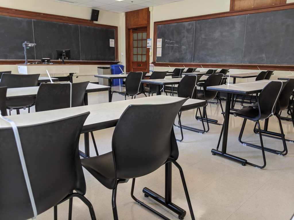 Photograph of an empty classroom in Garrison Hall on UT Austin's campus