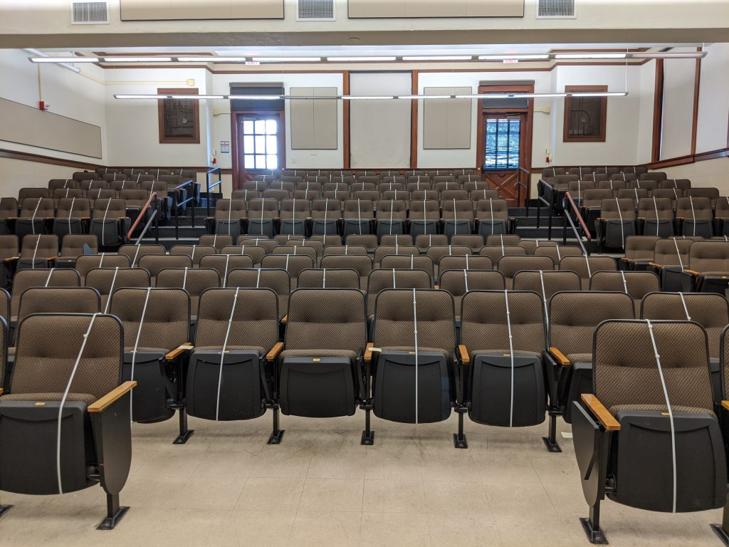 Photograph of an empty auditorium in Garrison Hall on UT Austin's campus