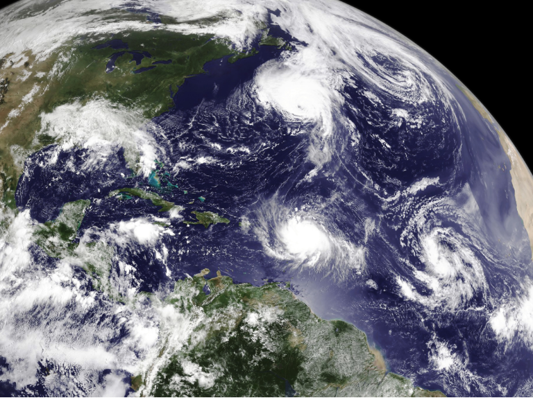 Image from space depicting several hurricanes crossing the Atlantic Ocean