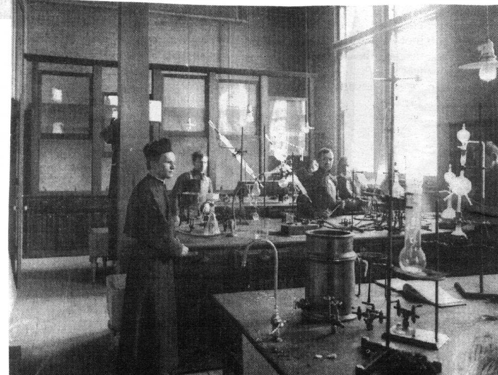 Father Julius Nieuwland in his laboratory in the old chemistry building at the University of Notre Dame in South Bend, Indiana